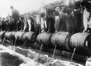 ca. 1920's --- Barrels of beer emptied into the sewer by authorities during prohibition. Undated photograph. BPA2# 4180 --- Image by © Underwood & Underwood/CORBIS